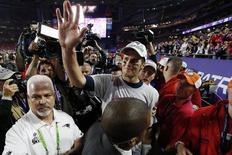 Feb 1, 2015; Glendale, AZ, USA; New England Patriots quarterback Tom Brady (12) walks off the field after beating the Seattle Seahawks in Super Bowl XLIX at University of Phoenix Stadium. Matthew Emmons-USA TODAY Sports