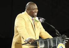 New inductee Warren Sapp talks during his acceptance into the NFL Pro Football Hall of Fame in Canton, Ohio August 3, 2013. REUTERS/Aaron Josefczyk