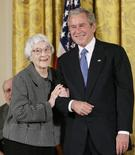 U.S. President George W. Bush (R) before awarding the Presidential Medal of Freedom to American novelist Harper Lee (L) in the East Room of the White House, in this file photo taken November 5, 2007.  REUTERS/Larry Downing/Files