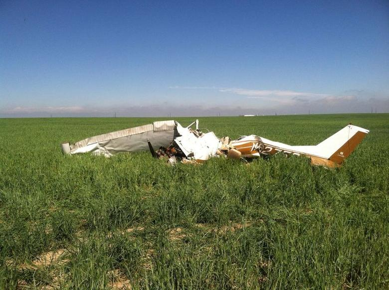 The wreckage of a crashed Cessna 150 airplane lies in a field near Watkins, Colorado on May 31, 2014. REUTERS/Sgt Aaron Pataluna/Adams County Sheriff/handout via Reuters