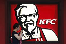A customer walks past a KFC store in Shanghai July 22, 2014. REUTERS/Aly Song