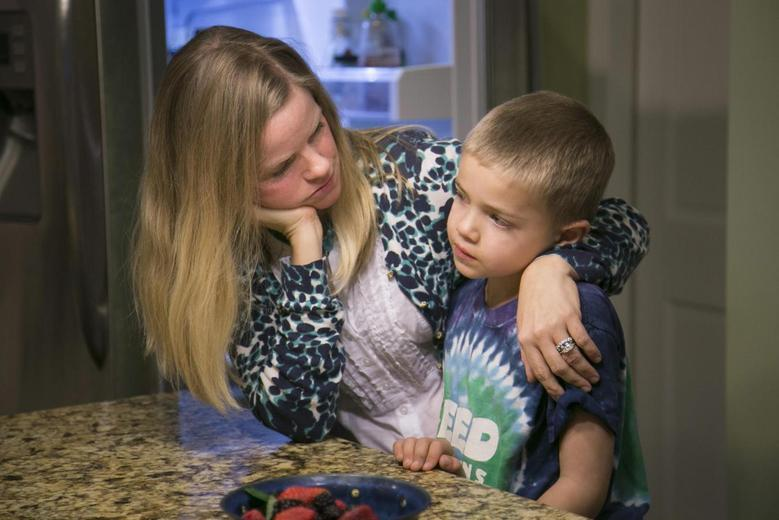 Jodi Krawitt holds her son Rhett, 6, in their home in Corte Madera, California January 28, 2015.  Rhett is recovering from leukemia and his father is concerned his child could succumb to an outbreak of measles at his Northern California school. Krawitt is asking officials to bar entry to any student not vaccinated because of a family's personal beliefs. REUTERS/Elijah Nouvelage