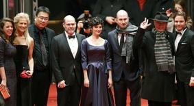 Members of the international jury and Berlinale Director Dieter Kosslick (2nd R) arrive for the screening of the movie 'Nobody Wants the Night', during the opening gala of the 65th Berlinale International Film Festival, in Berlin February 5, 2015.  REUTERS/Fabrizio Bensch