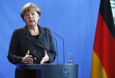 Канцлер Германии Ангела Меркель на пресс-конференции в Берлине. 6 февраля 2015 года. Канцлер Германии Ангела Меркель сказала, что не уверена, сумеют ли она и президент Франции Франсуа Олланд достичь прорыва на посвященных украинскому урегулированию переговорах с Владимиром Путиным в пятницу вечером. REUTERS/Hannibal Hanschke