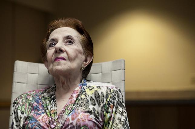 Mabel Ladicani, an 88-year-old widow living in San Juan and long time client of the UBS, looks up during an interview with Reuters in San Juan January 21, 2015. Reuters/Alvin Baez-Hernandez
