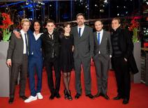 "Director Sebastian Schipper (3rd R) and cast members, Max Mauff (L-R), Burak Yigit, Franz Rogowski, Laia Costa, Frederick Lau and Andre Hennicke, arrive on the red carpet for the screening of the in competition movie ""Victoria"" at the 65th Berlinale International Film Festival in Berlin February 7, 2015. REUTERS/Stefanie Loos"