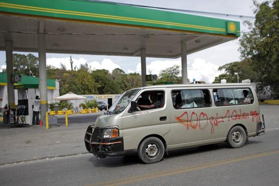A minivan used for public transportation drives past a gasoline station in Port-au-Prince February 8, 2015. REUTERS-Andres Martinez Casares