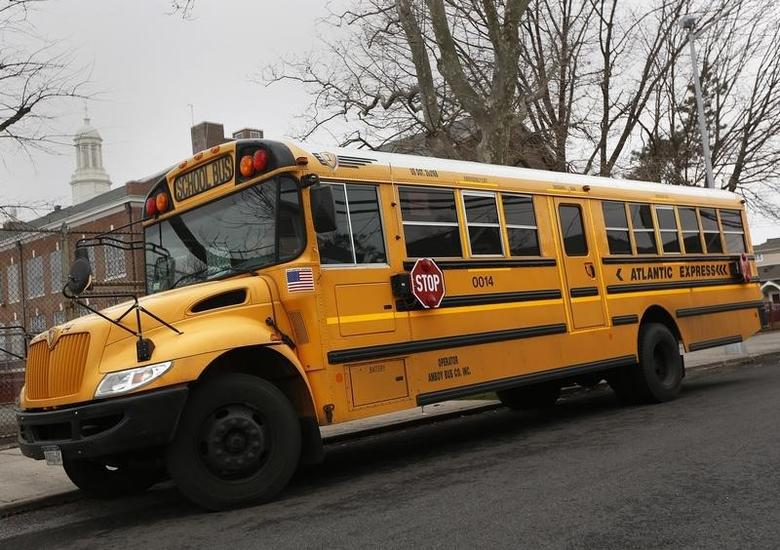 A school bus used for transporting New York City public school students is seen parked in front of a school in the Queens borough of New York January 15, 2013. REUTERS/Shannon Stapleton