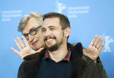 Actor James Franco and director Wim Wenders (L) pose during a photocall to promote the movie 'Every Thing Will Be Fine' at the 65th Berlinale International Film Festival, in Berlin February 10, 2015.    REUTERS/Hannibal Hanschke