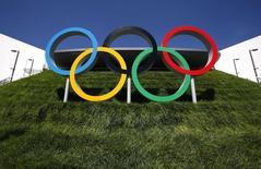 The Olympic rings are pictured next to the Aquatics Centre in London, in this file photo dated July 22, 2012.     REUTERS/David Gray