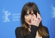 Actress Dakota Johnson arrives for the screening of the movie 'Fifty Shades of Grey' at the 65th Berlinale International Film Festival in Berlin February 11, 2015.                           REUTERS/Stefanie Loos
