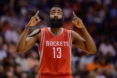 Feb 10, 2015; Phoenix, AZ, USA; Houston Rockets guard James Harden (13) points to the sky against the Phoenix Suns at US Airways Center. The Rockets won 127-118. Mandatory Credit: Joe Camporeale-USA TODAY Sports