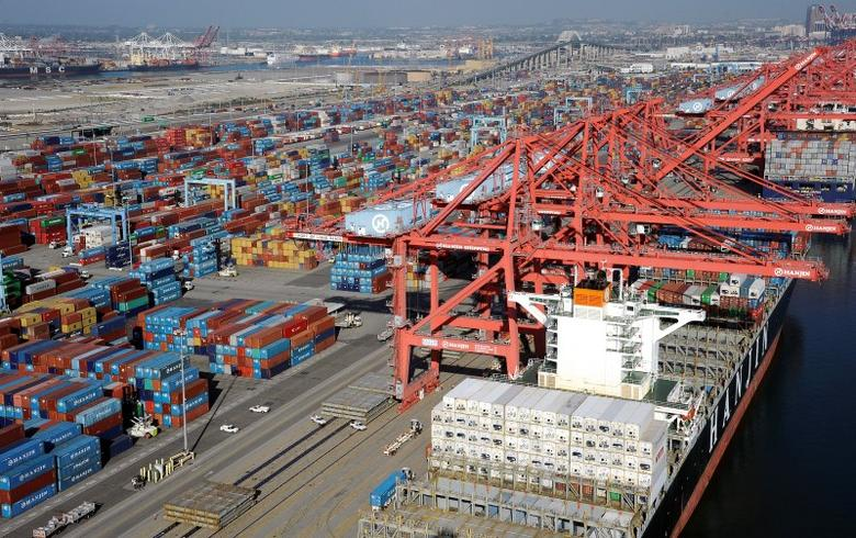 Cranes and containers are seen at the Ports of Los Angeles and Long Beach, California February 6, 2015 in this aerial image. REUTERS/Bob Riha Jr