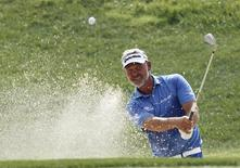 Darren Clarke of Northern Ireland chips onto the 17th green during the third day of practice for the 96th PGA Championship at Valhalla Golf Club in Louisville, Kentucky, in this file photo taken on August 6, 2014.  REUTERS/ John Sommers II