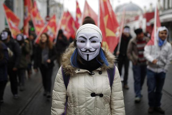 A high school student wearing a Guy Fawkes mask takes part in a protest against the education policies of the ruling AK Party in Istanbul February 13, 2015. REUTERS-Murad Sezer