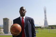 Former NBA star Dikembe Mutombo of U.S. poses before the start of a news conference at the Sports Congress and Exhibition at Aspire Dome in Doha November 12, 2012. REUTERS/Fadi Al-Assaad