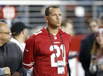 Dec 20, 2014; Santa Clara, CA, USA; New York Yankees baseball player Alex Rodriguez watches the San Francisco 49ers warm up before the game against the San Diego Chargers at Levi's Stadium. Mandatory Credit: Bob Stanton-USA TODAY Sports