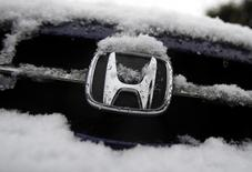 A logo of Honda Motor Co covered by snow is seen on a car parked on a street in Tokyo January 30, 2015. REUTERS/Yuya Shino