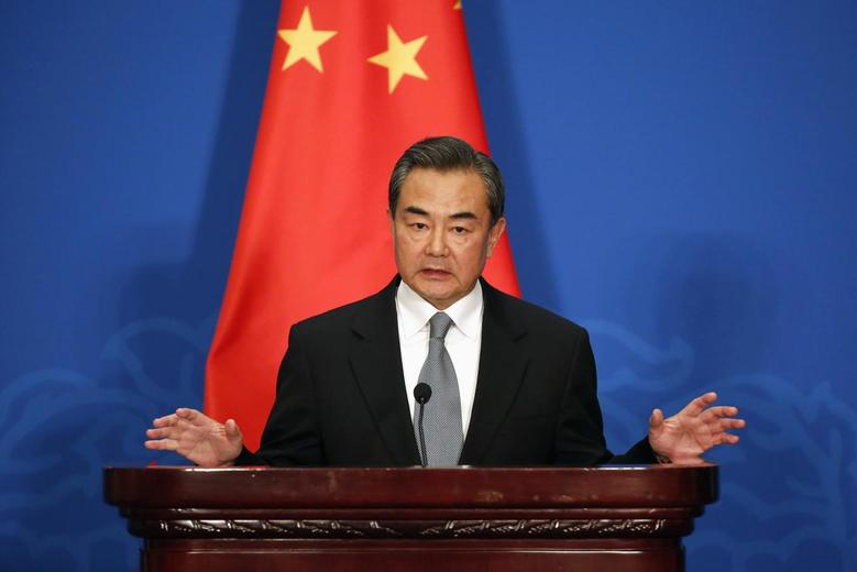 Chinese Foreign Minister Wang Yi attends a news conference after the 13th Russia-India-China Foreign Ministers' Meeting, at Diaoyutai State Guesthouse in Beijing, February 2, 2015. REUTERS/Wu Hong/Pool
