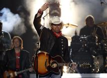"Toby Keith waves after performing ""Shut Up and Hold On"" at the 49th Annual Academy of Country Music Awards in Las Vegas, Nevada in this file photo taken April 6, 2014.   REUTERS/Robert Galbraith"