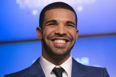 Rapper Drake smiles during an announcement that the Toronto Raptors will host the NBA All-Star game in Toronto, in this September 30, 2013, file photo.  REUTERS/Mark Blinch
