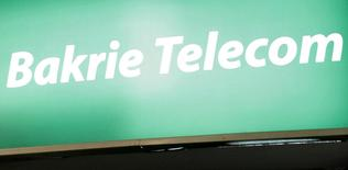 A logo of Bakrie Telecom is seen at the Bakrie building in Jakarta in this October 7, 2008 file photo. REUTERS/Dadang Tri/Files