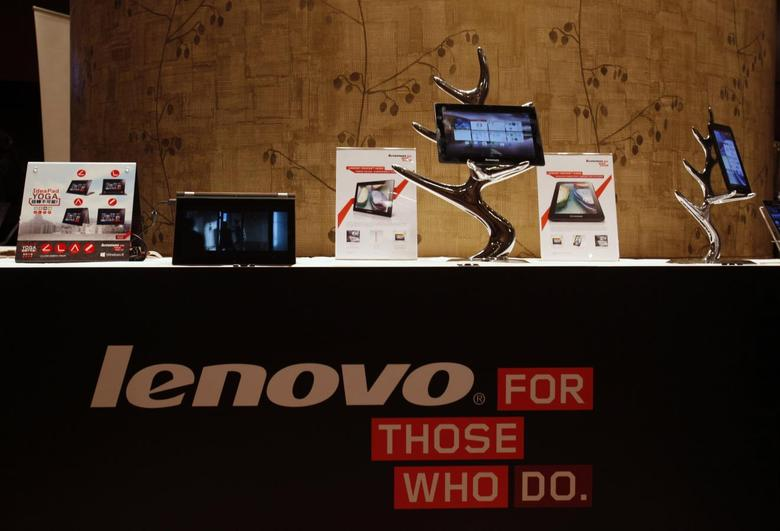 Lenovo tablets and mobile phones are displayed during a news conference on the company's annual results in Hong Kong in this May 23, 2013 file photo. REUTERS/Bobby Yip/Files