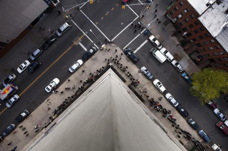 Jobseekers stand in line around the block to attend the Dr. Martin Luther King Jr. career fair held by the New York State department of Labor in New York April 12, 2012.  REUTERS/Lucas Jackson