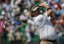 Miguel Angel Jimenez of Spain watches his tee shot on the fourth hole during the first round of the British Open Championship at the Royal Liverpool Golf Club in Hoylake, northern England July 17, 2014.   REUTERS/Stefan Wermuth