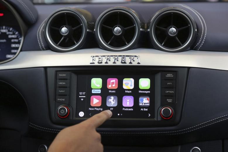 Apple's Stephen Chick displays the CarPlay program at the Worldwide Developers Conference in San Francisco, California in this June 2, 2014 file photo.  REUTERS/Robert Galbraith