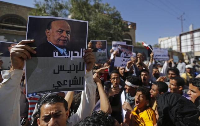 A protester holds up a poster of Yemen's former president Abd-Rabbu Mansour Hadi during an anti-Houthi demonstration in Sanaa February 21, 2015. REUTERS/Khaled Abdullah