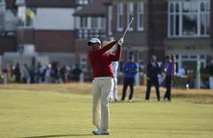 Anirban Lahiri of India watches his second shot on the third hole during the first round of the British Open Championship at the Royal Liverpool Golf Club in Hoylake, northern England July 17, 2014.   REUTERS/Toby Melville