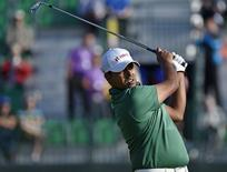 Anirban Lahiri of India watches his tee shot on the fourth hole during the first round of the British Open Championship at the Royal Liverpool Golf Club in Hoylake, northern England July 17, 2014.  REUTERS/Toby Melville