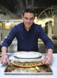 American chef Gavin Kaysen poses with a prepared char in an undated photo in the kitchen of his restaurant Spoon and Stable in Minneapolis, Minnesota, provided by Bonjwing Photograph. REUTERS/Bonjwing Photograph/Handout via Reuters
