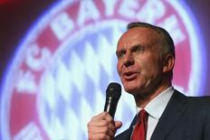 Bayern Munich CEO Karl-Heinz Rummenigge speaks at the team's after-match party in Berlin May 18, 2014. REUTERS/Alexander Hassenstein/Pool