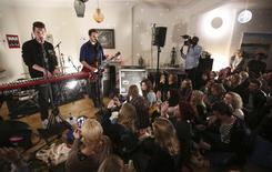 Bastille perform to a room full of fans at a gig in a house in north London, February 23, 2015. Just over a hundred lucky fans gathered in a London flat on Monday night to sing along with British electro-pop quintet Bastille at a special gig for the War Child charity. The intimate show was part of the Sofar Sounds events - small, exclusive gigs that are held in carefully selected spaces in more than 50 cities worldwide. REUTERS/Paul Hackett (BRITAIN - Tags: ENTERTAINMENT SOCIETY TPX IMAGES OF THE DAY)