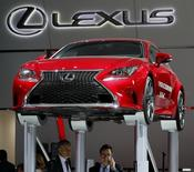 A Lexus F Sport is displayed on pedestals during the second press day of the North American International Auto Show in Detroit, Michigan, January 13, 2015.  REUTERS/Mark Blinch