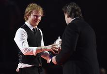 Ed Sheeran celebrates with Russell Crowe after receiving the British Album of the Year award at the BRIT music awards at the O2 Arena in Greenwich, London, February 25, 2015. REUTERS/Toby Melville