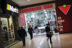 People walk out of a Canadian Tire Store that is located by a Mark's clothing store, which is owned by Canadian Tire Corporation in Toronto, May 8, 2014.  REUTERS/Mark Blinch