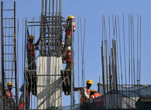 Labourers work at the site of a monorail project in Mumbai February 27, 2015. REUTERS-Shailesh Andrade