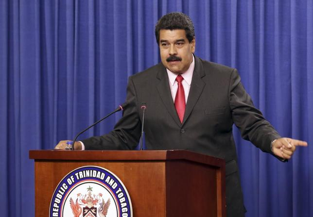 Venezuela's President Nicolas Maduro addresses the audience at the Diplomatic Centre in Port-of-Spain, February 24, 2015. REUTERS/Andrea De Silva/Trinidad and Tobago Prime Minister's Office/Handout via Reuters
