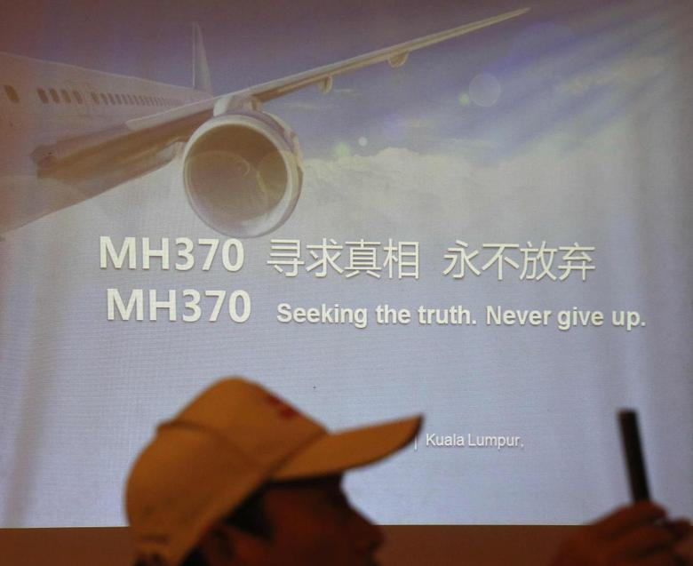 Relatives of some of the Chinese passengers who were on board the missing Malaysia Airlines flight MH370 outline their demands to the airline at a news conference in Kuala Lumpur February 20, 2015. REUTERS/Olivia Harris