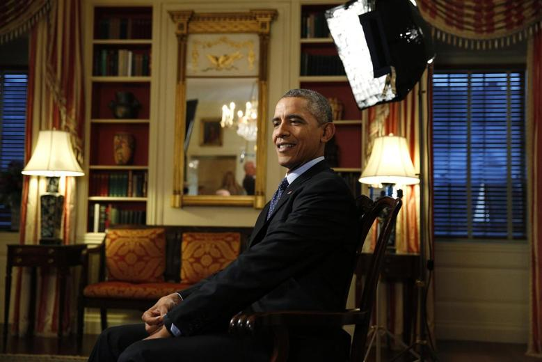 U.S. President Barack Obama takes his seat for an exclusive interview with Reuters in the Library of the White House in Washington March 2, 2015.  REUTERS/Kevin Lamarque