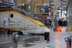 An idle high speed Eurostar train is seen through glass panels at the Paris Gare du Nord train station after the suspension of rail traffic due to smoke coming out of the Channel tunnel January 17, 2015.   REUTERS/Stephane Mahe