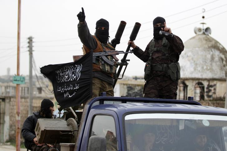 Members of al Qaeda's Nusra Front gesture as they drive in a convoy touring villages, which they said they have seized control of from Syrian rebel factions, in the southern countryside of Idlib, December 2, 2014.REUTERS/Khalil Ashawi