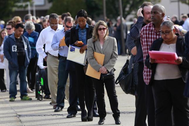 People wait in line to enter the Nassau County Mega Job Fair at Nassau Veterans Memorial Coliseum in Uniondale, New York October 7, 2014.  REUTERS/Shannon Stapleton