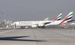 Emirates Airlines planes are parked at the Dubai International Airport during the second day of the Dubai Airshow November 14, 2011. REUTERS/Nikhil Monteiro