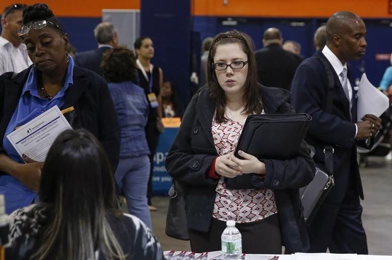 People speak with job recruiters at the Nassau County Mega Job Fair at Nassau Veterans Memorial Coliseum in Uniondale, New York October 7, 2014. REUTERS/Shannon Stapleton