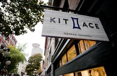 A sign hangs outside the Kit and Ace flagship store in Vancouver, British Columbia in this file photo taken on October 17, 2014. REUTERS/Ben Nelms