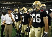Notre Dame alumni coach Lou Holtz (L) directs to his team before the start of the Notre Dame Japan Bowl football game against Japan in Tokyo July 25, 2009. REUTERS/Issei Kato